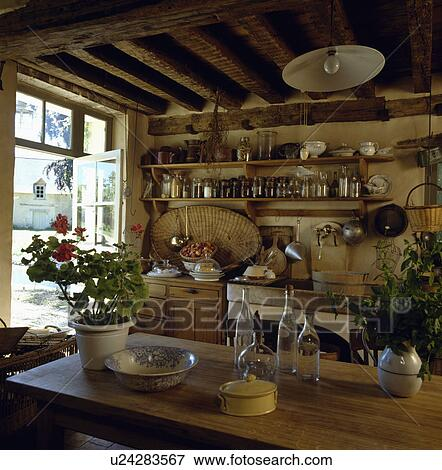Picture   Rustic Cottage Kitchen With Wooden Table And Shelving. Fotosearch    Search Stock Photography