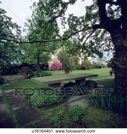 Stock Photography Of Stone Bench In Large Italian Country Garden