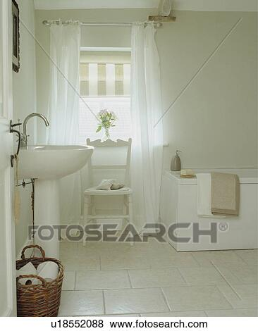 Pictures Of Traditional White Bathroom With Wicker Basket And Roman - Roman blind bathroom