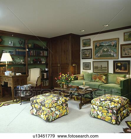 Genial Stock Photograph   Upholstered Yellow Floral Stools And Green Sofa In  Traditional Living Room. Fotosearch