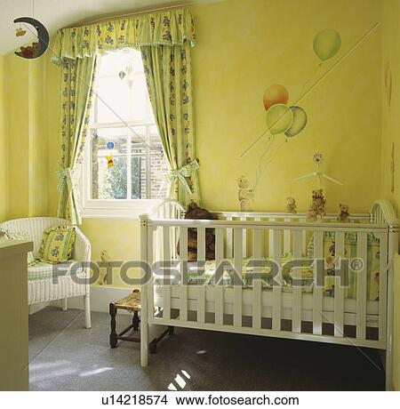 White Cot And Green Yellow Curtains In Nursery Bedroom With Painted Mural Of Child Balloons On The Wall Picture