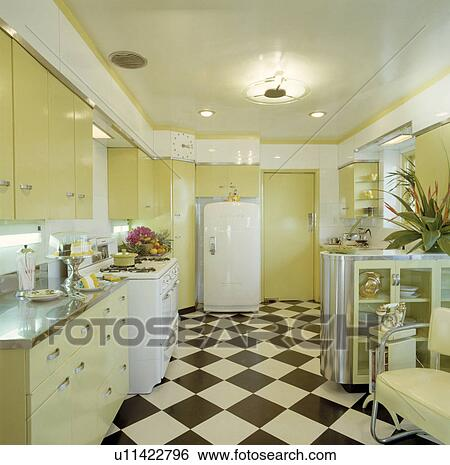 Black White Chequerboard Flooring In Pastel Yellow Modern Kitchen With Large Refrigerator Stock Photograph U11422796 Fotosearch