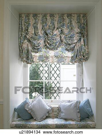 Prime Blue And White Festoon Blind Above Blue And White Cushions Pabps2019 Chair Design Images Pabps2019Com