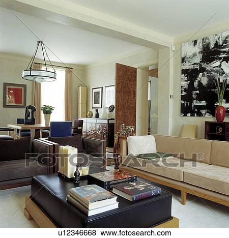 Cream and brown suede sofas in large modern living room ...