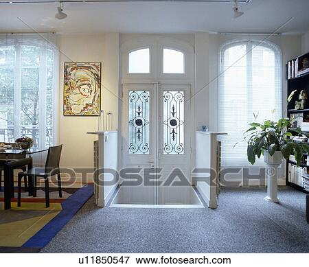 Picture Of Grey Carpet And Double White Doors With Glass Panels In
