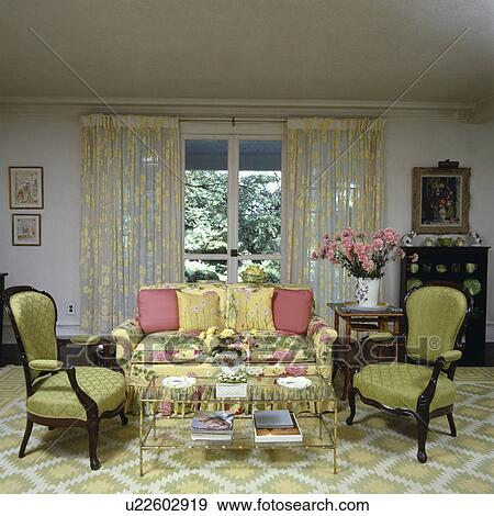 Lace curtains and green chairs in traditional living room Stock Photo