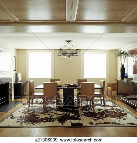 Stock Photograph Of Highback Neutral Leather Chairs And Black - Cowhide rug dining room