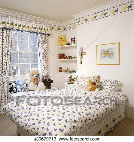 Curtains Ideas curtains matching wallpaper : Stock Photo of Blue+yellow duck-patterned duvet and matching ...