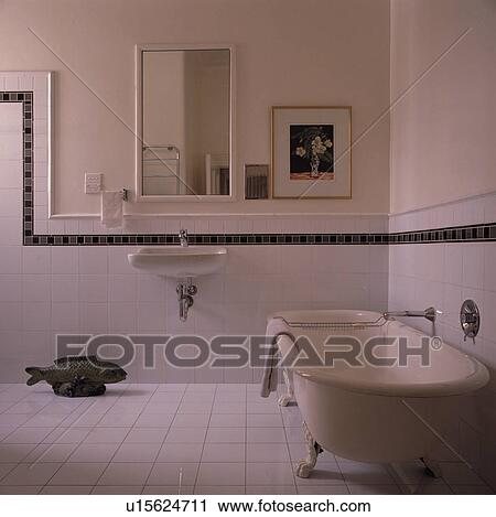 White Clawfoot Bath In Bathroom With Tiled Wall And Black Border To Dado Height