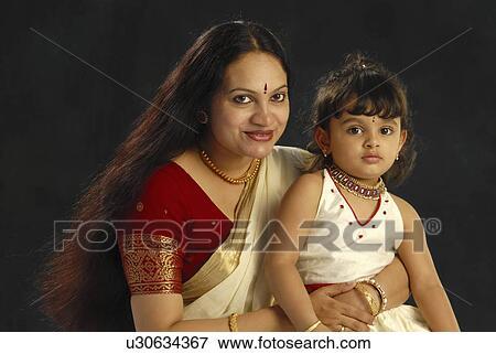f5a839f65d child mother kerala in attire onam daughter Stock Photo | u30634367 ...