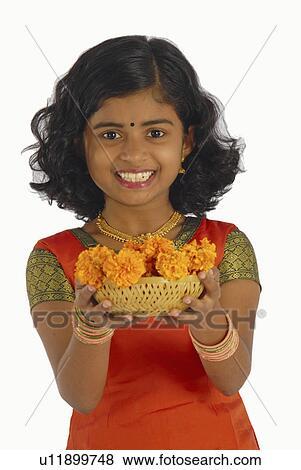 a63574b00d Stock Photo - flowers girl child model kerala in attire onam. Fotosearch