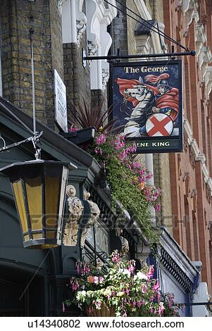 England, London, Westminster, The George public house in Great Portland  Street  The pub sign shows an image of St George  Stock Image