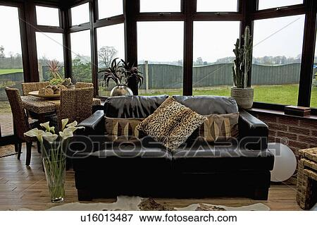 Animalprint Cushions On Black Leather