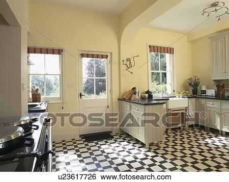 Stock Images of Black+white vinyl flooring in pastel yellow country ...