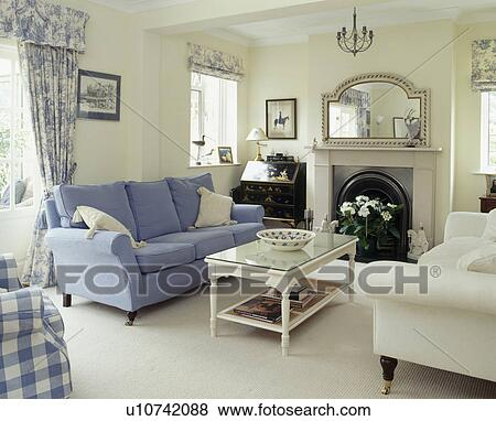 Blue And Cream Sofa In Country Living Room