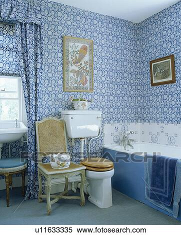 Blue+white wallpaper and matching curtains in traditional bathroom