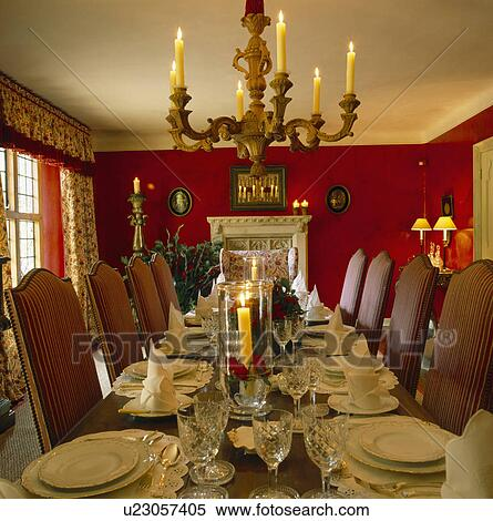 Miraculous Candle Chandelier Above Table With Place Settings In Traditional Red Dining Room With Upholstered Chairs Stock Photography Interior Design Ideas Tzicisoteloinfo