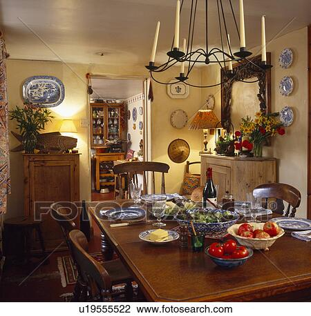 Astounding Candles In Metal Chandelier Above Wooden Table Set For Dinner In Yellow Country Dining Room Stock Image Download Free Architecture Designs Crovemadebymaigaardcom