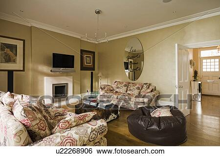 Miraculous Circular Modern Mirror Above Patterned Sofa In Beige Living Pdpeps Interior Chair Design Pdpepsorg