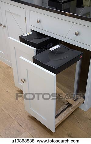 Close-up of recycling bins in pull-out kitchen storage drawers Stock Photo