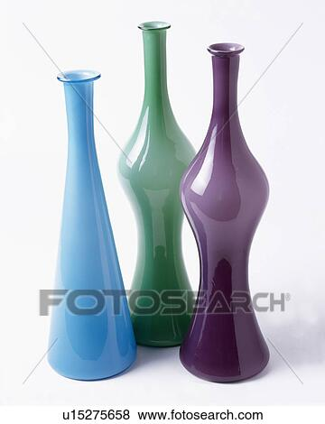 Pictures Of Close Up Of Tall Blue And Purple Glass Vases With Green