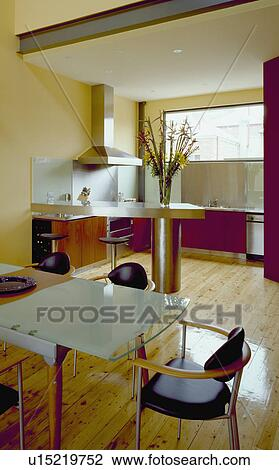 Glass Dining Table In Modern Open Plan Kitchen Room With Pale Wooden Flooring