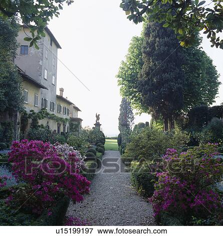 Gravel Path Through With Pink Azaleas In Formal Garden Of Italian Country Villa