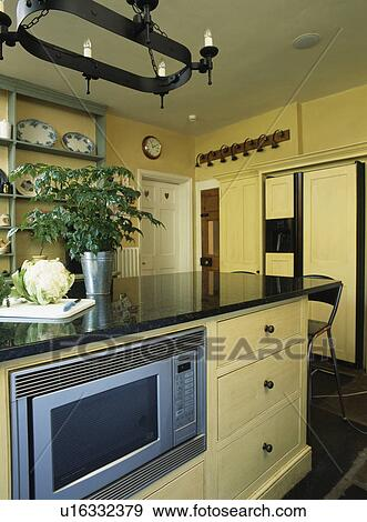 Island Unit With Ed Microwave Oven In Modern Country Kitchen