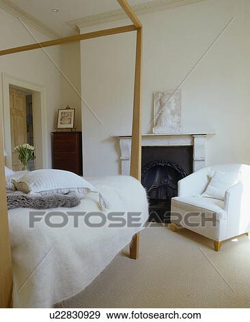Stock Photograph Of Modern Four Poster Bed In White Bedroom With