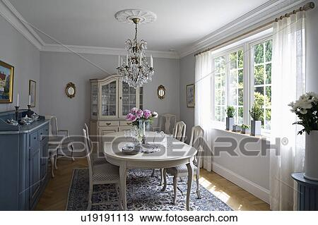 Swedish Gl Chandelier Above White Table And Chairs In