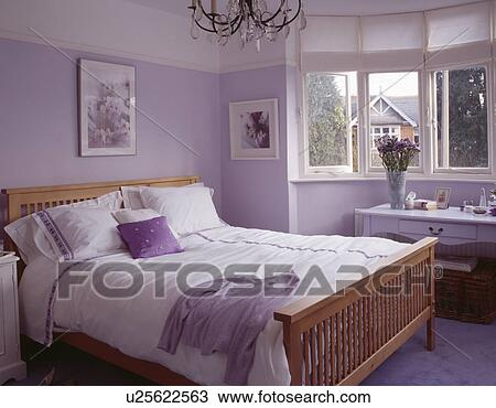 Stock Photo White Bedlinen On Wooden Bed In Mauve Bedroom Fotosearch Search