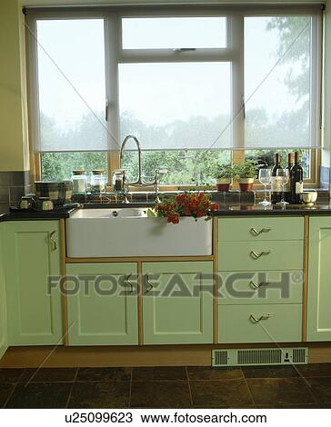 Stock Photo Of White Blind On Window Above Belfast Sink In