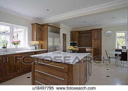Stock Image White Granite Worktop On Island Unit In Modern Kitchen Dining Room Extension