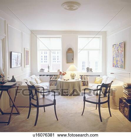 Stock Photography Of White Sofas And Antique Dining Chairs In