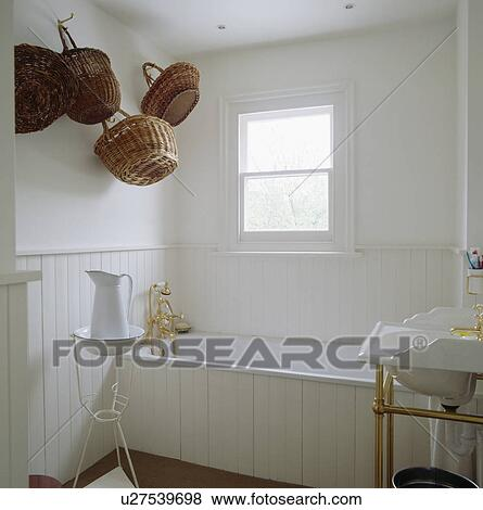 Picture White Wood Panelled Bathroom With Baskets Hanging On The Wall Fotosearch