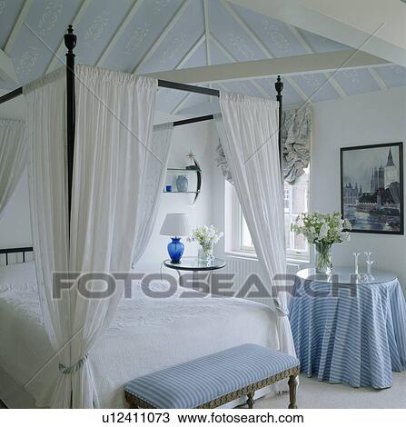 Stock Photo Of Bed With White Drapes And Linen In White Bedroom With