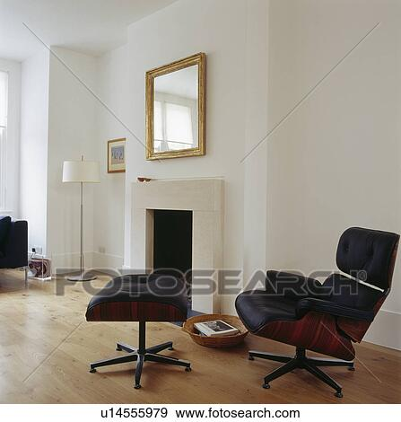 Superb Black Leather Charles Eames Lounge Chair And Stool Beside Bralicious Painted Fabric Chair Ideas Braliciousco