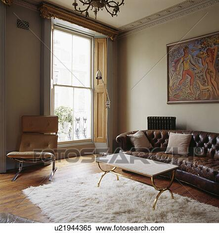 Miraculous Brown Leather Chesterfield Sofa And Metal Framed Coffee Creativecarmelina Interior Chair Design Creativecarmelinacom