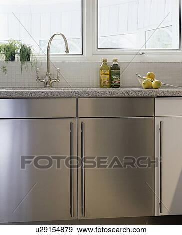 Chrome Mixer Tap Above Stainless Steel Kitchen Unit Stock Photo U29154879 Fotosearch