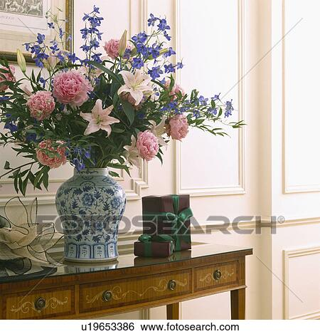 Close Up Of Pink And Blue Flowers In Informal Flower Arrangement In Blue White Vase Stock Photograph U19653386 Fotosearch