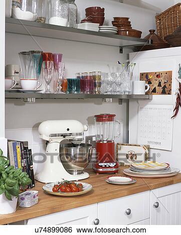 Close Up Of Red Kitchenaid Blender And White Kitchenaid Mixer Stock Photograph
