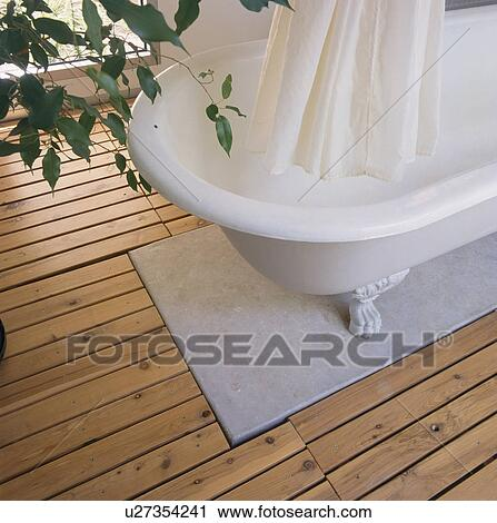 Stock Photography of Close-up of white shower curtain and rolltop ...