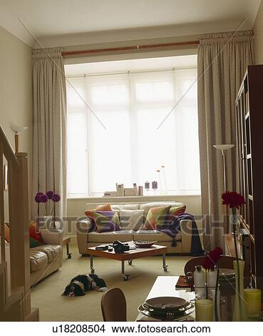 Colourful Cushions On Cream Leather Sofas In Small Living Room With Cream Curtains Picture