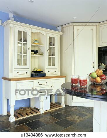 Cream dresser in pastel blue country kitchen & Stock Images of Cream dresser in pastel blue country kitchen ...