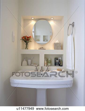 Downlighting Above Oval Mirror In