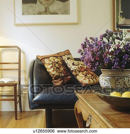 Dried Flower Arrangement On Table In Living Room With Tapestry Cushions On Leather Sofa Stock Photograph U12655906 Fotosearch