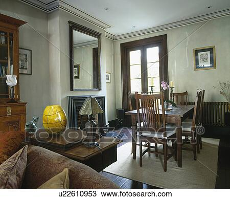 Edwardian Chairs And Table In Old Fashioned Dining Room