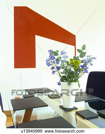 Granite Placemats And Blue Flower Arrangement On Modern Gl Dining Table Stock Photograph Of