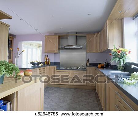 Grey Flooring In Mauve Kitchen With Pale Wood Fitted Units And Grey Tiled  Floor