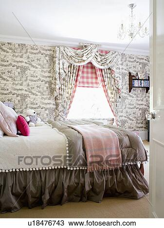 Grey Toile De Jouy Wallpaper And Curtains In Country Bedroom With Checked  Blanket And Grey Quilt On Bed